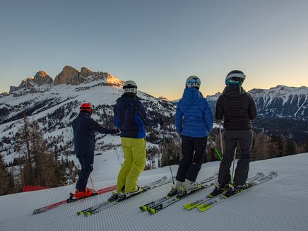 Early bird skiing in Carezza Dolomites